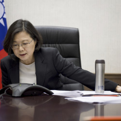 In this photo released by the Taiwan Presidential Office, Taiwan's President Tsai Ing-wen speaks with U.S. President-elect Donald Trump through a speaker phone in Taipei on Friday. The call was a breach of protocol as the U.S. government recognizes Taiwan as a part of China.