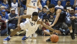 Duke's Matt Jones, left, and Maine's Austin Howard, right, fight for a loose ball during the first half of the Blue Devils' 94-55 victory Saturday in Durham, North Carolina.