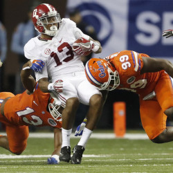 Alabama receiver ArDarius Stewart is hit by Jachai Polite, left, and Daniel McMillian of Florida after making a catch during the second half of the Southeastern Conference championship game Saturday in Atlanta. Alabama won 54-16 and is expected to return to Atlanta on Dec. 31 for a national semifinal.