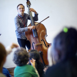 Portland Symphony musician Brian Thacker can take a bow as plays a contrabass while working with kindergartners at Longfellow Elementary School on Nov. 7 as part of the PSO Explorers Program that uses music to enhance teaching of core subjects.