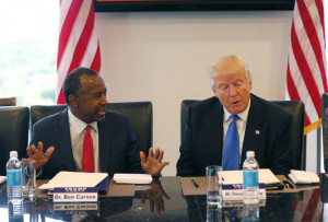 In this Aug. 25, 2016 photo, former Republican presidential candidate Dr. Ben Carson during Republican presidential candidate Donald Trump's roundtable meeting with the Republican Leadership Initiative in his offices at Trump Tower in New York. Trump has chosen former Campaign 2016 rival Ben Carson to become secretary of the Department of Housing and Urban Development.