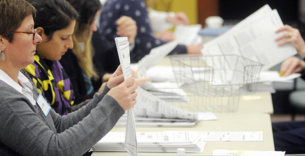 Ballots are recounted Monday in Augusta for the referendum question to legalize recreational marijuana in Maine.