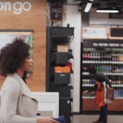 A shopper enters an Amazon Go store in this image taken from video. Customers swipe their smartphone on the way in and their selections are tracked as they shop.
