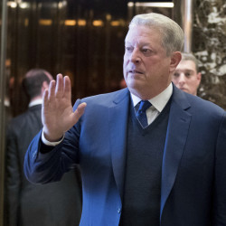 """Former Vice President Al Gore waves to the media after meeting with Ivanka Trump and President-elect Donald Trump on Monday. Trump has called climate change a """"hoax,"""" but Gore said he and Trump had a """"sincere search for areas of common ground"""" in their meeting."""