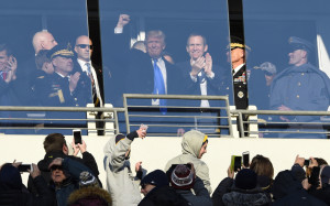 President-elect Donald Trump waves to the crowd from a suite at M&T Bank Stadium in Baltimore Saturday afternoon during the 117th annual Army-Navy football game.