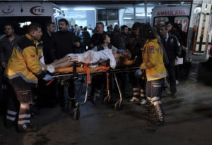 Rescue and medics carry a wounded person after attacks in Istanbul late Saturday. Two explosions struck Saturday night outside a major soccer stadium.