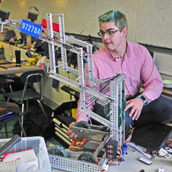Somerset Career and Technical Center team member Andrew Todd works on his robot in the pits before competing Saturday in the VEX robotics contest at Hall-Dale High School in Farmingdale. Students worked on robots in the cafeteria between contests in the gymnasium.