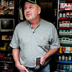 The newly erected cellphone tower off the Sugar Hill Road in Harmony allows C&R General Store owner Ron Robinson the use of his cellphone from inside his store in Harmony on Thursday.