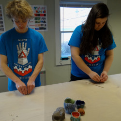 Team members William Fahy, left, and Hazel Houghton of Hall-Dale High School's Delta Prime Robotics learn to craft pinch pots at Hallowell Clayworks in preparation for their Pots for Bots family fundraiser on Sunday.