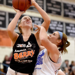 Skowhegan's Annie Cooke, left, draws a foul from Madison defender Marah Hall during the second annual Amanda Berry Scholarship game on Tuesday night in Skowhegan.