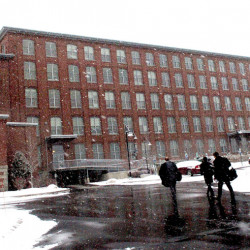 People on Monday enter the Hathaway Creative Center in Waterville, which is for sale.