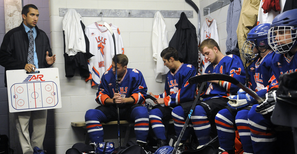 Dakota Gendreau preps his team prior to a preseason game against Messalonskee at Bonnefond Ice Arena in Kents Hill on Wednesday night.