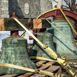 The three largest of the 12 bells removed from St. Mark's Episcopal Church sit on a trailer Thursday in front of the Augusta church and are headed for a New York, where they will be offered for sale.