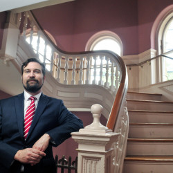 New Hallowell City Manager Nate Rudy poses for a photo June 30 in City Hall. He said he doesn't plan to recommend a moratorium on marijuana stores or clubs at Monday's City Council meeting.