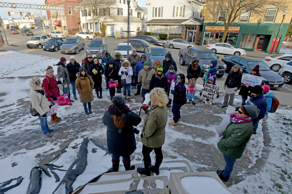 People gather outside Post Office Square for a Forward Together march on Main Street in Waterville on Saturday.