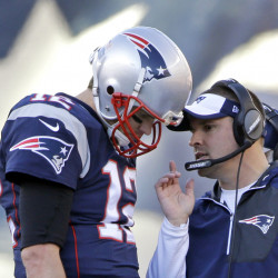 New England Patriots quarterback Tom Brady (12) confers with offensive coordinator Josh McDaniels during the first half of a game against the Los Angeles Rams in Foxborough, Massachusetts.