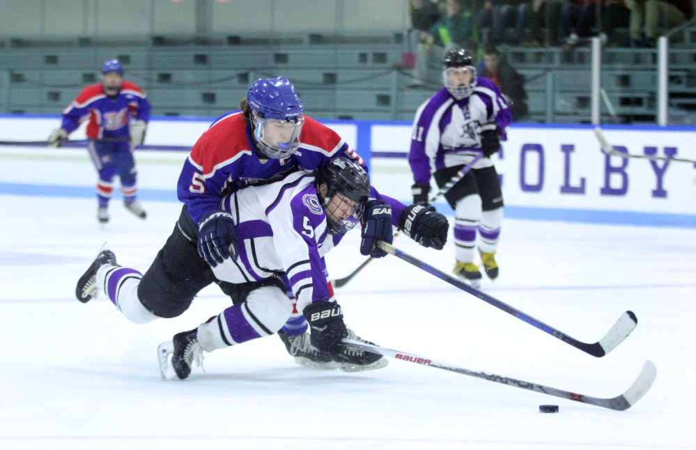 Messalonskee's Connor Smith, top, fights for the puck with Waterville's Andrew Roderigue during first-period action Thursday at Colby College in Waterville. Smith was called for a holding on the play.
