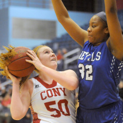 Cony's Lauren Coniff, left, shoots over Lewiston's Victoria Harris during a game Wednesday at the Capital City Hoop Classic in Augusta.