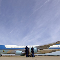 Military personnel salute as Air Force One, with President Barack Obama aboard, departs at Andrews Air Force Base, Md., on Nov. 6, 2016. President-elect Donald Trump wants the government's contract for a new Air Force One fleet to be canceled.  Associated Press/Jose Luis Magana