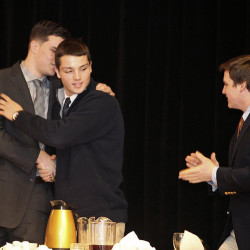 Joe Esposito of Portland High, center, is congratulated by fellow finalists Austin McCrum of Thornton Academy, left, and Will Bessey of Brunswick after he was awarded the 45th James J. Fitzpatrick Trophy during a ceremony in Portland on Jan. 24. Eleven semifinalists were announced Wednesday for this season's Fitzpatrick Trophy. Jill Brady/Staff Photographer