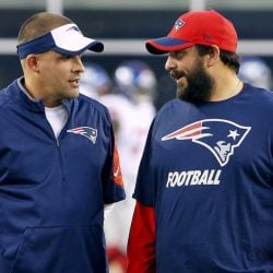 New England Patriots offensive coordinator Josh McDaniels, left, talks with defensive coordinator Matt Patricia before a 2015 game against the New York Giants in Foxborough, Massachusetts.