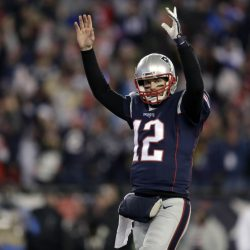 New England Patriots quarterback Tom Brady celebrates a touchdown by running back Dion Lewis during the second half of an NFL divisional playoff game Saturday against the Houston Texans in Foxborough, Massachusetts.