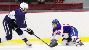 Hampden defenseman Pece Poulin, left, tries to get past Messalonskee sophomore Phillip Kaherl during a Class B North game Wednesday night at the Bonnefond Ice Arena on the campus of Kents Hill.
