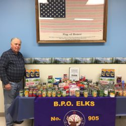 Waterville Elks Lodge 905 Exhaulted Ruler Lanni White with the donations made during the Waterville Elks Dick Willette Memorial Food Drive at Waterville Elks Lodge 905.