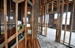 Connie Damboise works on the top floor of the former Hains Building on Main Street in Waterville on Friday. The building at 173 Main St. is being renovated as part of a $5 million project.
