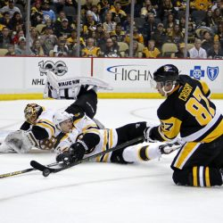 Pittsburgh's Sidney Crosby (87) tries to shoot in front of Boston's Torey Krug (47) and goalie Tuukka Rask, rear, during the second period Sunday in Pittsburgh.