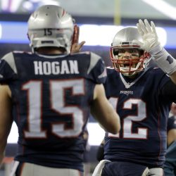 New England Patriots quarterback Tom Brady (12) celebrates with wide receiver Chris Hogan (15) after a touchdown pass against the Pittsburgh Steelers during the first half of the AFC championship game Sunday in Foxborough, Massachusetts.