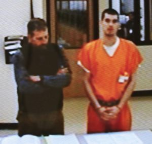 Damien Towers stands beside his attorney, Philip Mohlar, during a teleconference hearing Monday inside Skowhegan District Court on charges related to the robbery at the Skowhegan Rite Aid pharmacy on Jan. 9.