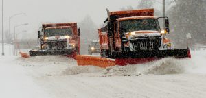 Waterville Public Works snowplow operators work side by side on College Avenue in Waterville on Dec. 12. Forecasts call for 3-6 inches of snow Tuesday into Wednesday as a nor'easter moves through the region.