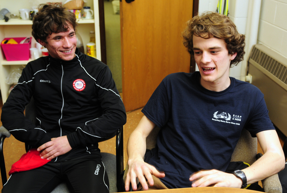 Maranacook Community High School senior Ruslan Reiter, left, laughs with close friend and Nordic ski teammate Zachary Holman on Thursday at the Readfield school.