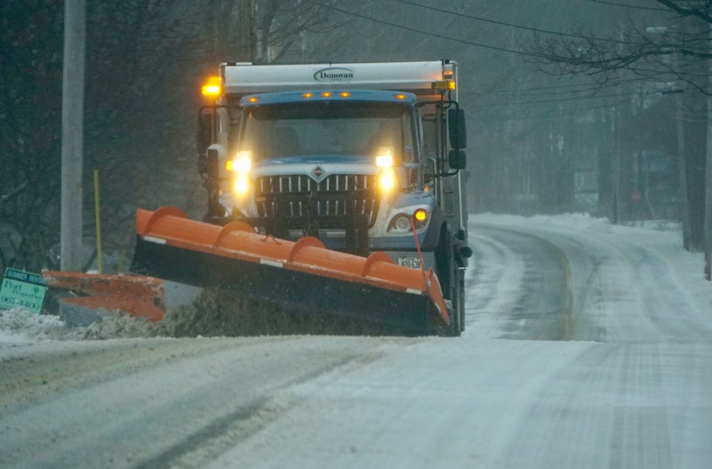 A snowplow makes its way along Sea Road in Kennebunk on Jan. 24.