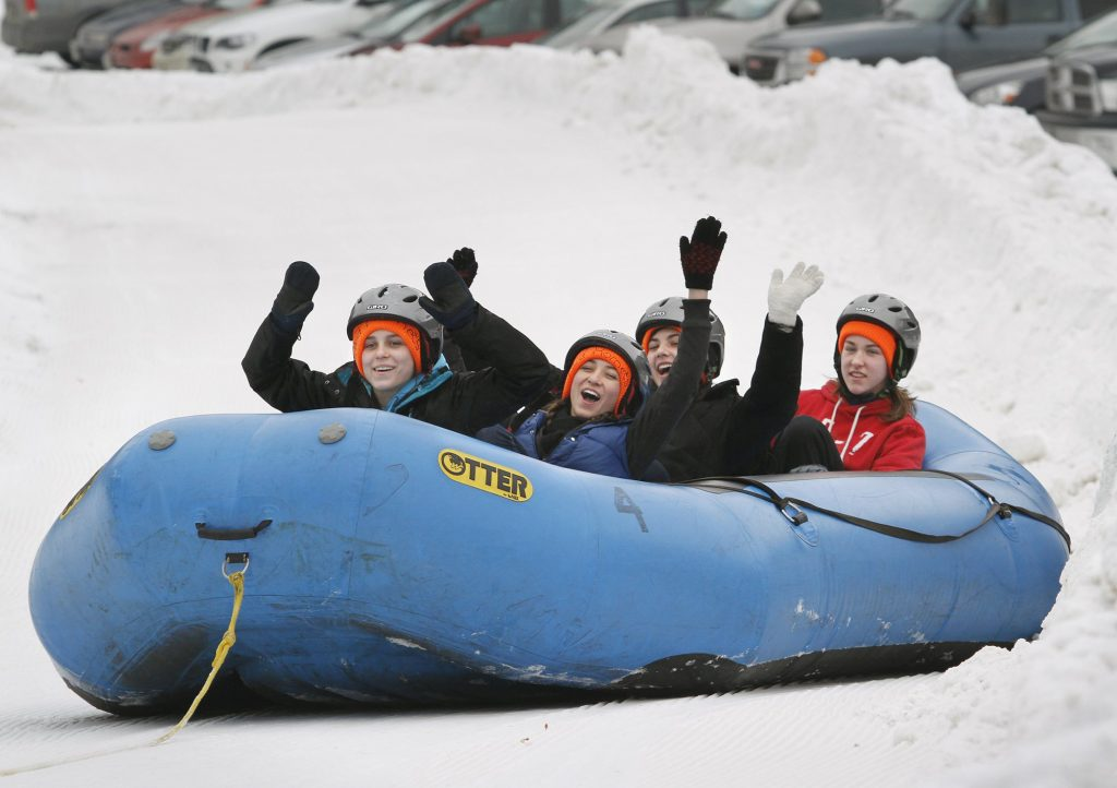 Staff Photo by Derek Davis:  MAINE EVENT.   Leavitt/Edward Little girls' hockey players take a test run down a hill at Lost Valley Ski Area as they prepare for the snow-rafting rides to raise money for their team.   From left, Taylor Landry, a freshman at Edward Little, Holly Gallup, a sophmore at Leavitt, Amanda Grenier, a freshman at Edward Little, and Kayla Royer, a junior at Leavitt.  The rides never opened on Saturday due to technical diffuculties, but they are still planned for Sunday, from 12-4pm at Lost Valley as a part of the Auburn Winter Festival.  Photographed on Saturday, January 29, 2011.