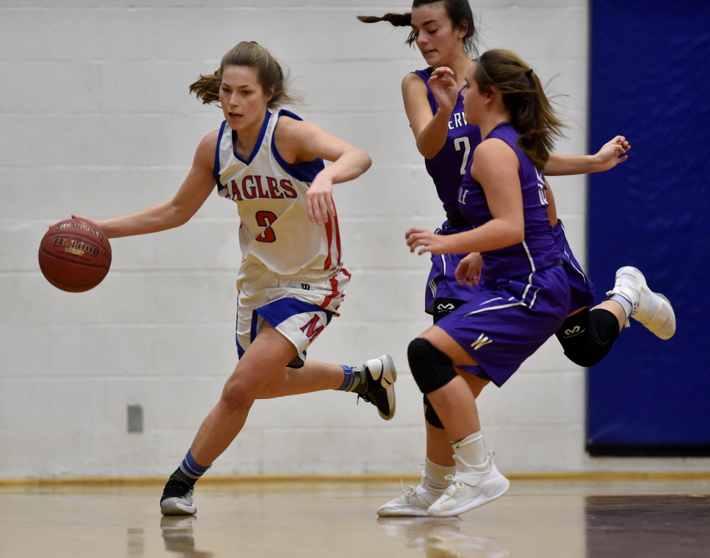 Messalonskee senior guard Sophie Holmes (3) dribbles the ball down the court as Waterville defenders give chase during a Kennebec Valley Athletic Conference Class A game earlier this season in Oakland.
