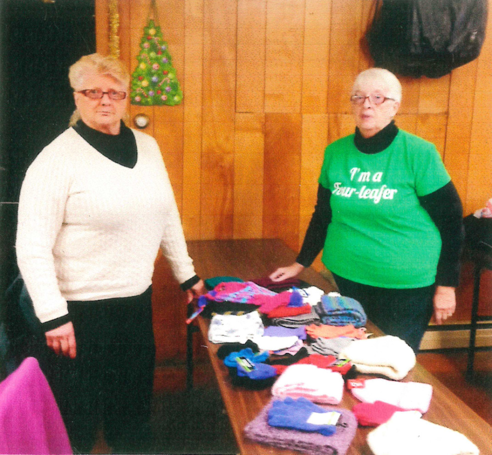 Members of the Four Leaf Clover Senior Club of Gardiner recently were involved in a collection of hats, mittens and scarfs, under the direction of Shirley Cunningham, left, coordinator of the Hat Project with President Johan Brown. The items were presented to the local Head Start Program.