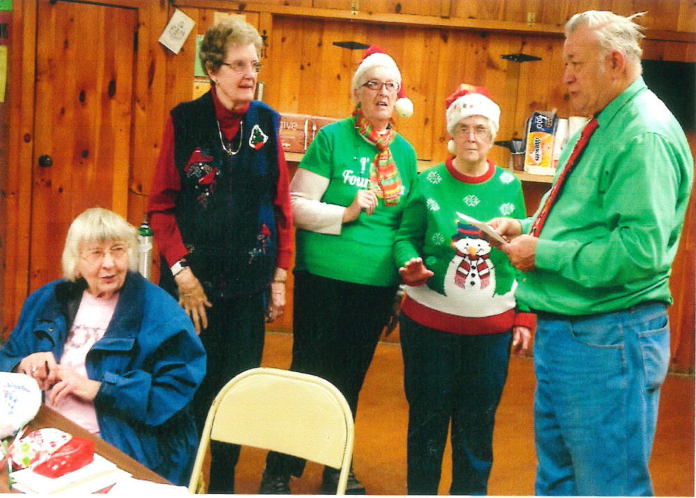 Past president David Smith, right, recently swore in the officers of the Four Leaf Clover Senior Club of Gardiner. From left, are Cathy Pazdziorko, chaplain; Beverly Heald, secretary; Johan Brown, president; and Marion Thomas, treasurer.