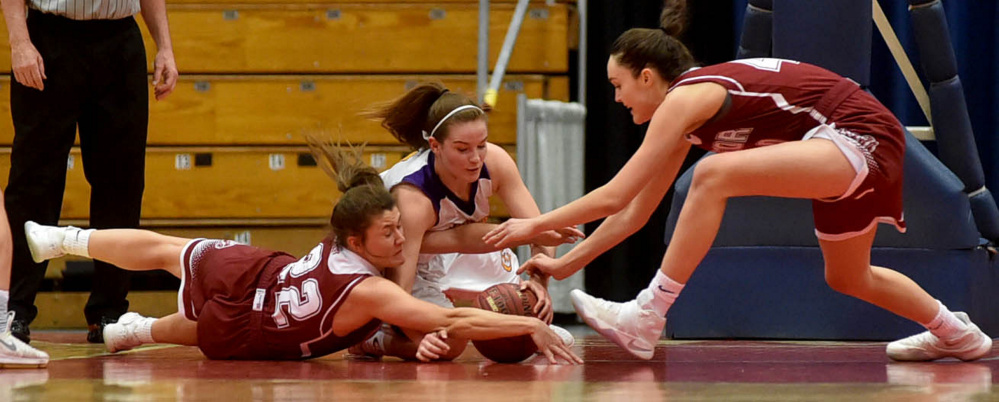 Staff photo by Michael G. Seamans   Bangor's Kira Yardley, left, dives for the loose ball as Cheverus' Kaylin Malmquist, center, and Bangor's Katie Butler battles for a loose ball during a Class AA North quarterfinal Thursday at the Augusta Civic Center.