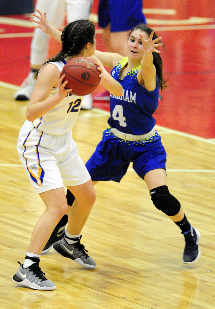 Boothbay's Kate Friant, left, looks to pass around as Mt. Abram guard Lindsay Huff defends during a Class C South quarterfinal game Monday at Augusta Civic Center.