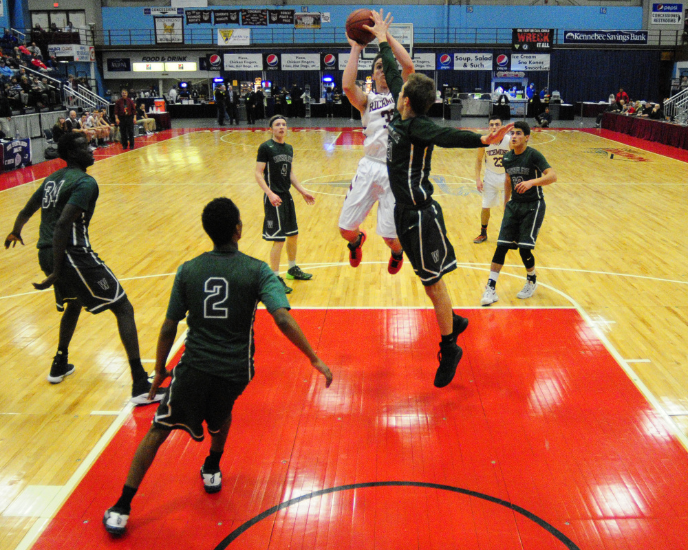 Richmond's Matt Holt, bottom, shoots as Waynflete's Christian Brooks tries to block the shot during a Class C South quarterfinal game Monday  at the Augusta Civic Center.
