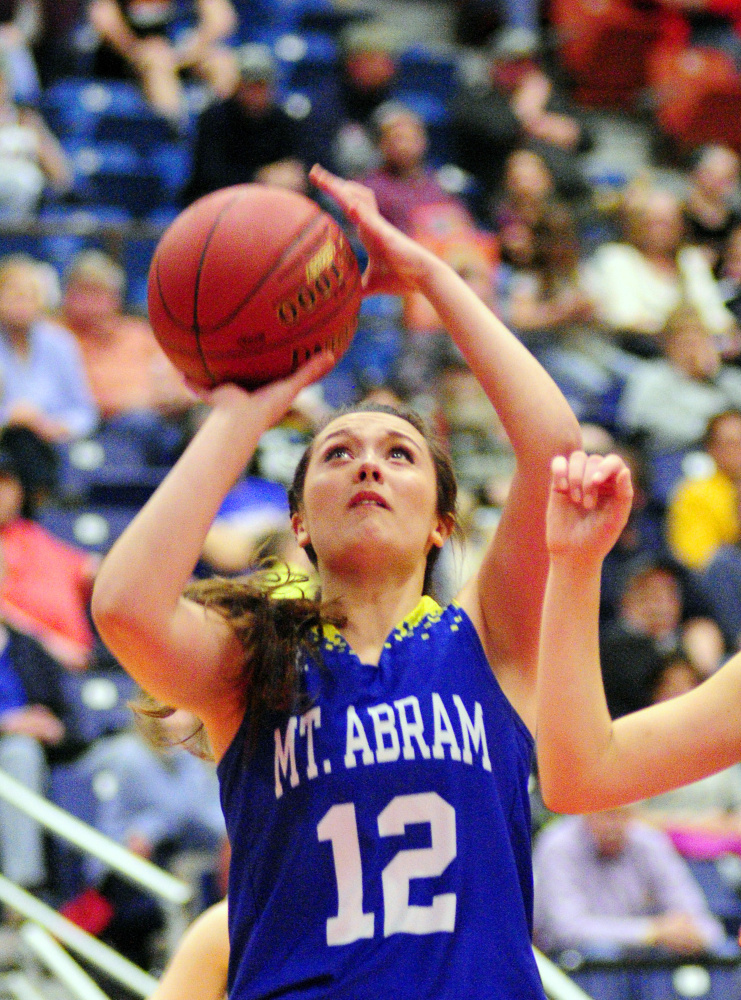Mt. Abram's Alora Ross shoots during a Class C South quarterfinal game on Monday at the Augusta Civic Center.