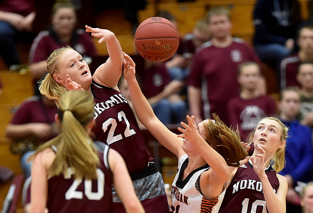 Nokomis sophomore Gabrielle Lord (22) fouls Skowhegan shooter Annie Cooke in the first half of a Class A North semifinal Wednesday afternoon at the Augusta Civic Center.
