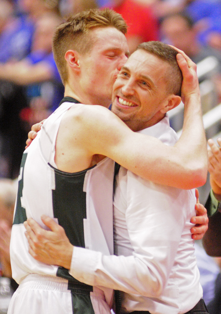 Winthrop coach Todd MacAurthur and Jacob Hickey embrace after the Class C South championship game Saturday at the Augusta Civic Center.