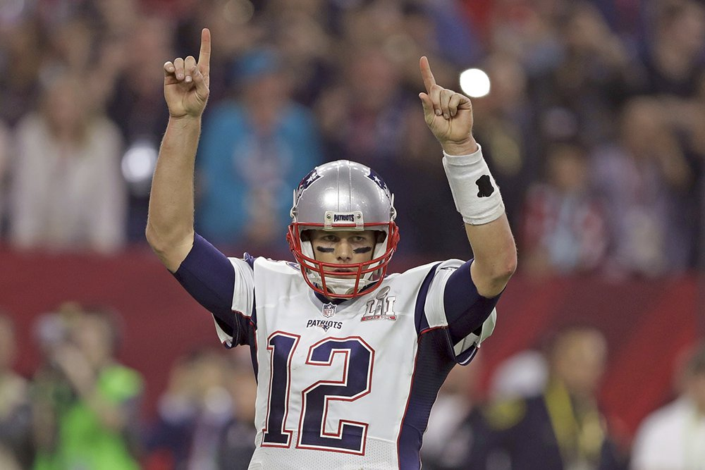 New England Patriots' Tom Brady raises his arms after a touchdown, during the second half of Super Bowl 51 Sunday.
