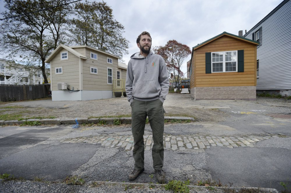 Brent Adler stands in October in front of the tiny houses he placed on Chapel Street. Attorney Nathaniel Huckel-Bauer, who is representing Adler's Federal Street Phoenix LLC, says the dispute with the city highlights the need to change local ordinances related to tiny houses.