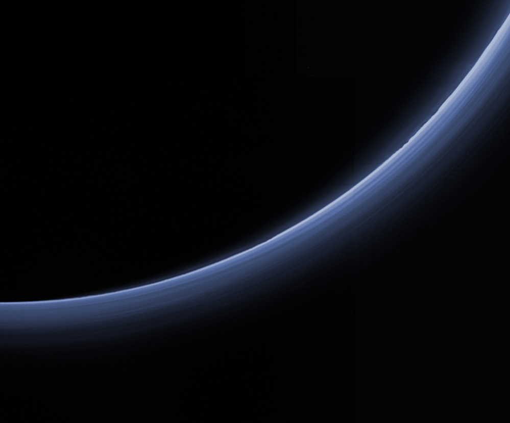 Haze around Pluto appears blue in this image captured by New Horizons and processed to replicate the color a human eye would see.
