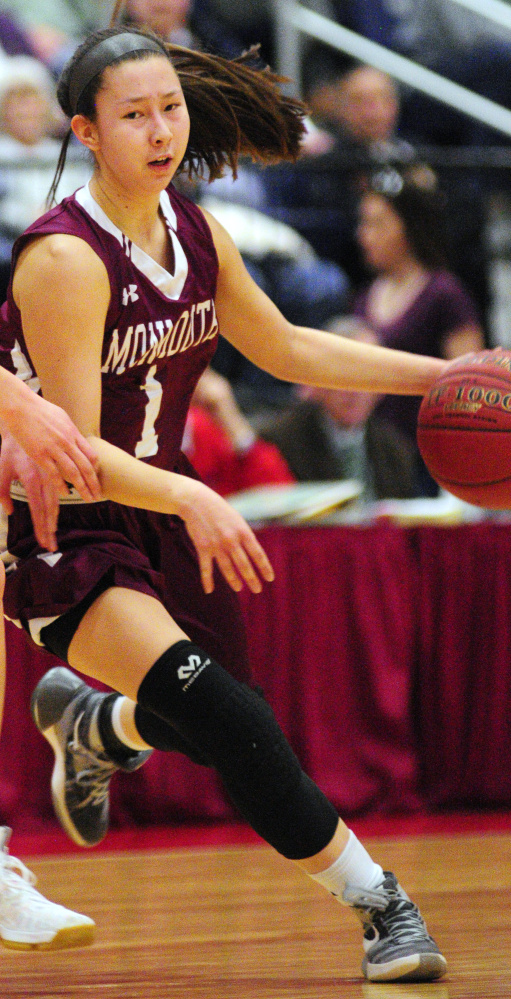 Monmouth's dribbles the ball against Boothbay during a Class C semifinal game last week at the Augusta Civic Center.