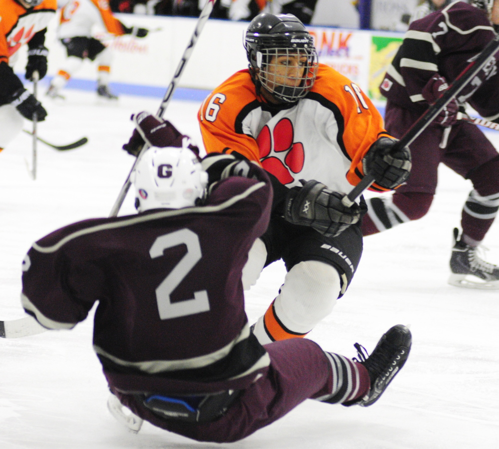 Gardiner defender Hunter Russell, top, gets past Greely forward Quinn Malloy during a 2015 game at the Camden National Bank Ice Vault in Hallowell.